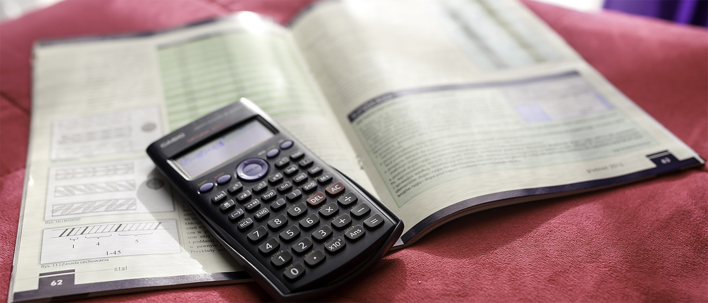 Calculator and Book Background Image